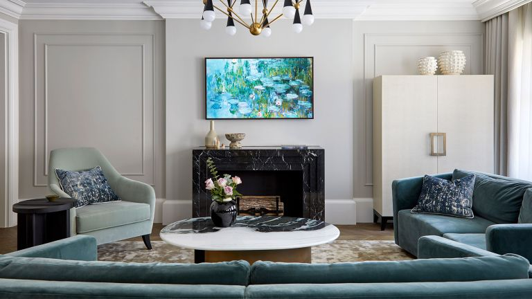 Mayfair apartment living room with green sofa and armchair