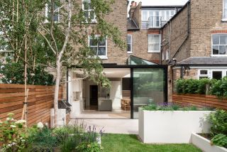 a modern kitchen extension with a glazed section