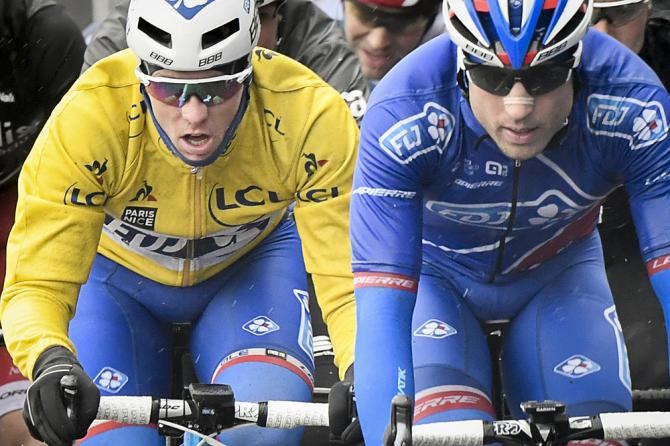 Arnaud Demare (FDJ), wearing the overall leader's yellow jersey,