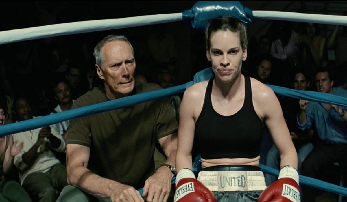Clint Eastwood and Hilary Swank sit in the corner of the ring in Million Dollar Baby.