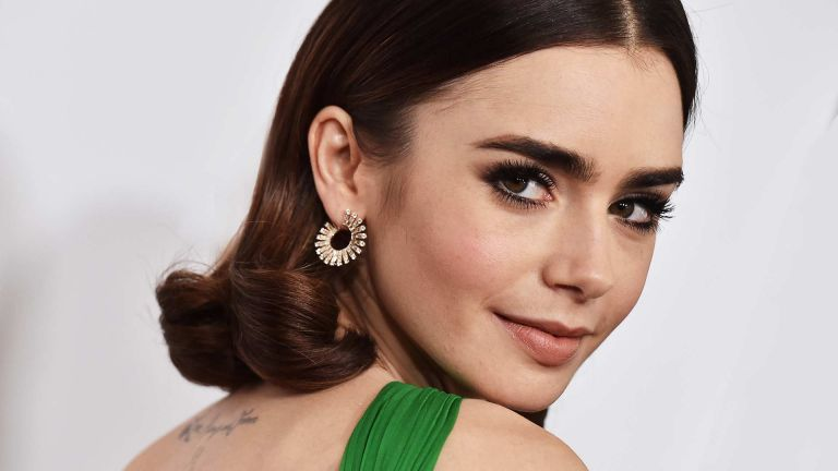 Actress Lily Collins arrives at the 28th Annual Producers Guild Awards at The Beverly Hilton Hotel on January 28, 2017 in Beverly Hills, California.