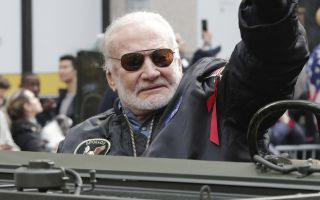 Apollo 11 astronaut Buzz Aldrin, seen here in a 2019 Veteran's Day parade in New York City, has received his first vaccination shot for COVID-19.