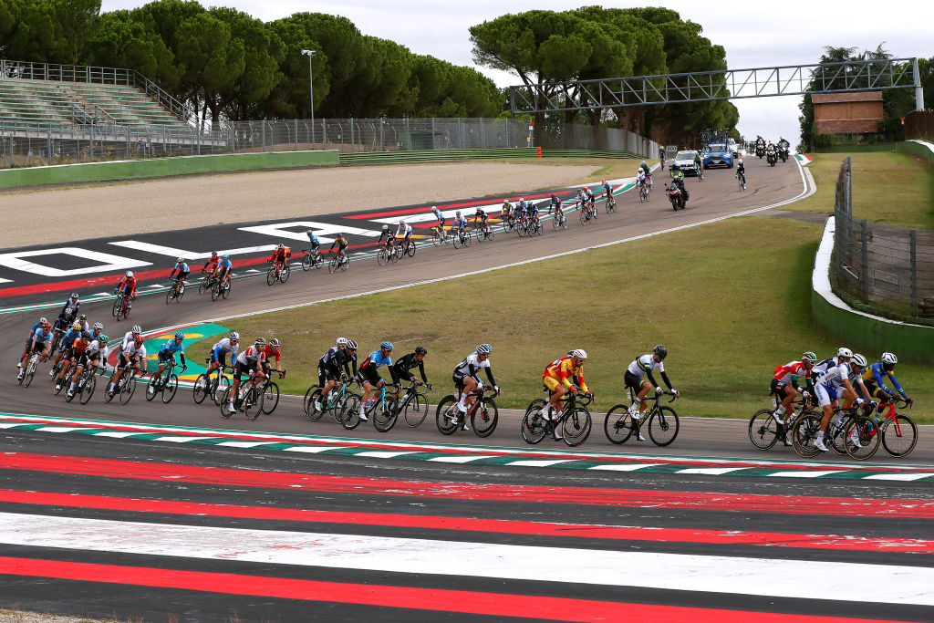 The peloton in the men's road race passes through the Imola race circuit