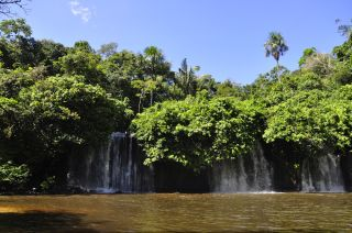 This photo depicts a waterfall on the Juma River near the town of Apui, in Amazonas State. Sweating from the hike to reach it, Walker swam across the pool at its base, only to worry halfway to the other side about possible anacondas lurking in the depths.