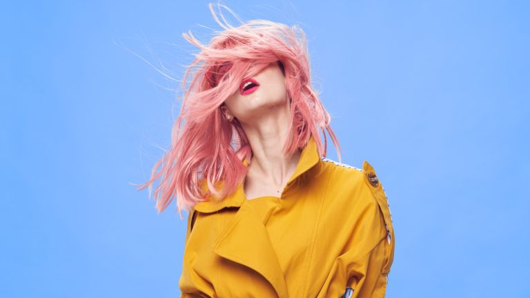 what color suits me – woman with pink hair in colorful clothes