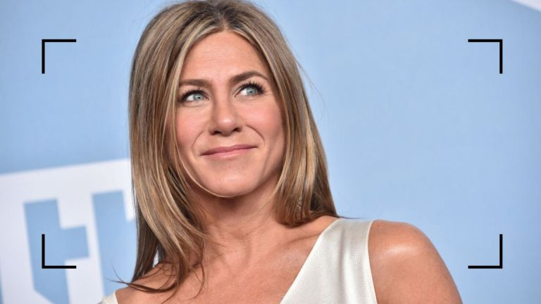 Jennifer Aniston close up of her at an awards show with glowing skin