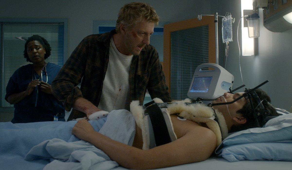 Cobra Kai William Zabka standing over a student's hospital bed