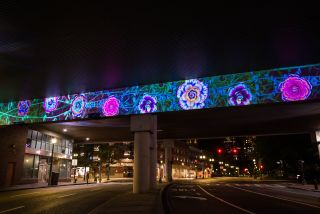 """Multidisciplinary design team Studio HHH used 24 Epson Pro L laser solutions to bring the unique public art installation """"Urban Underpass"""" to life, brightening the underpass at Bullfinch Crossing in Boston with an immersive canvas that showcases animations created by local and international artists."""