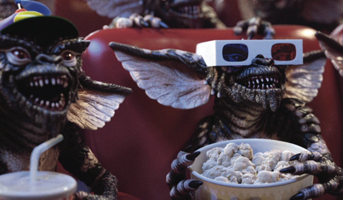 Gremlins enjoying a movie and some popcorn