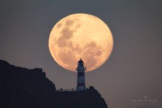 Supermoon Rising Behind a Lighthouse in New Zealand