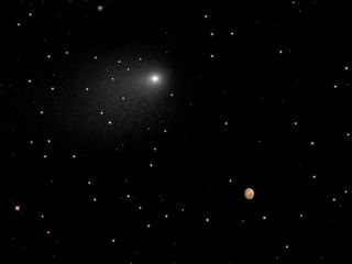Hubble Views Comet Siding Spring and Mars