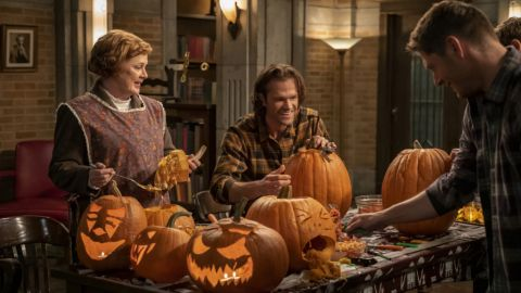 Sam, Dean and Mrs. Butters carve their pumpkins.