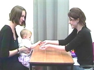 A baby and his mom participate in a study