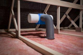 a positive input ventilation unit installed in a loft