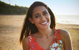 Josephine Jobert smiling as DS Florence Cassell in Death in Paradise