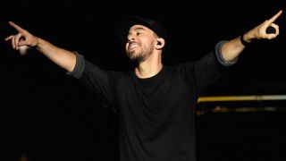 Mike Shinoda onstage, pointing