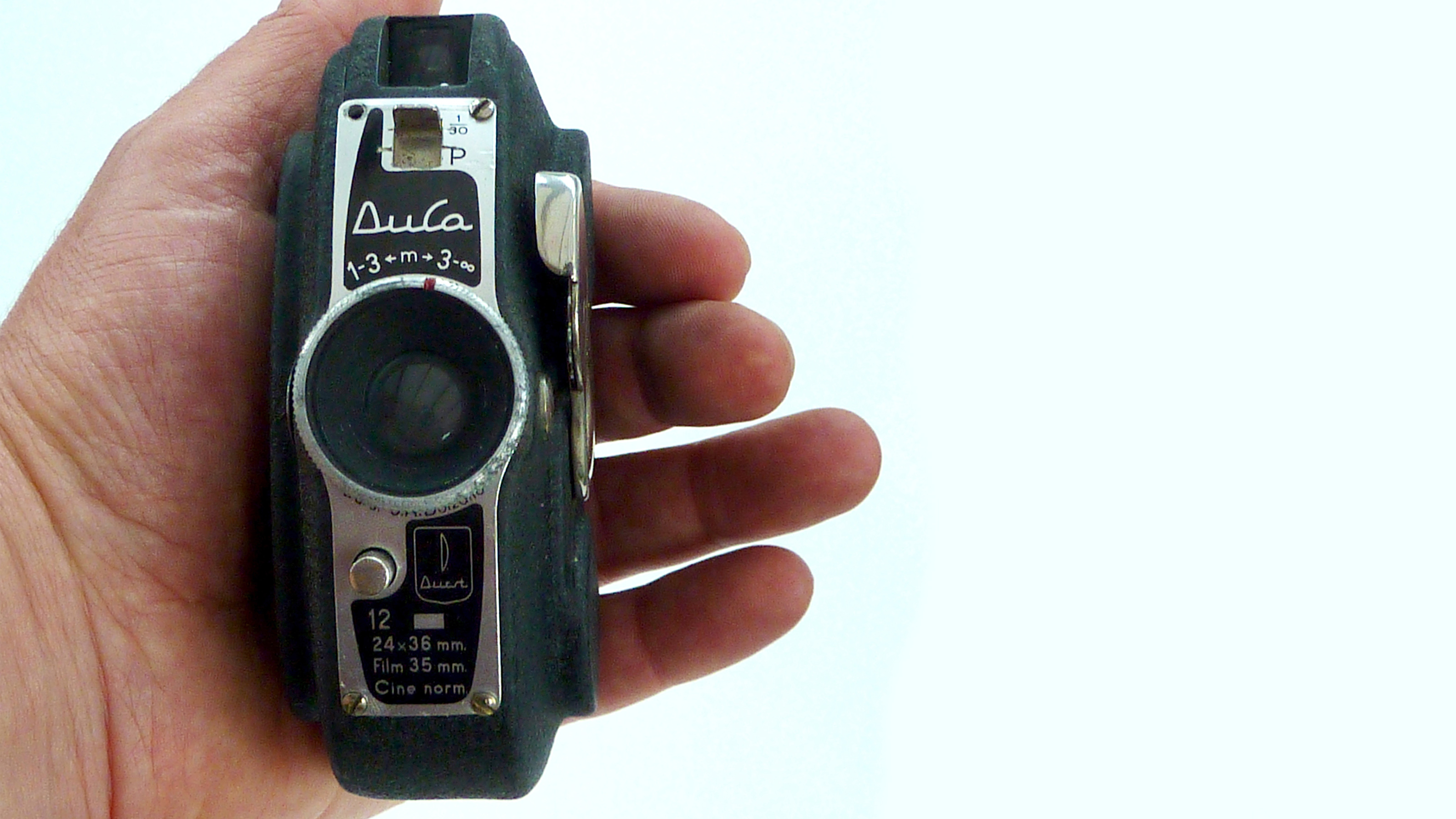 A hand holding the Durst Duca camera