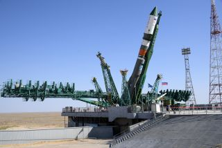 A Russian Soyuz rocket carrying the uncrewed Progress 76 cargo ship is hoisted into launch position atop its pad at Baikonur Cosmodrome, Kazakhstan ahead of a July 23, 2020 launch.