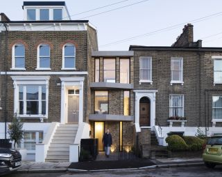 a narrow infill house between two properties