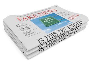 "A newspaper has a headline reading ""Fake News."""
