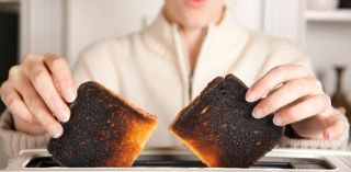 Burned toast coming from the toaster