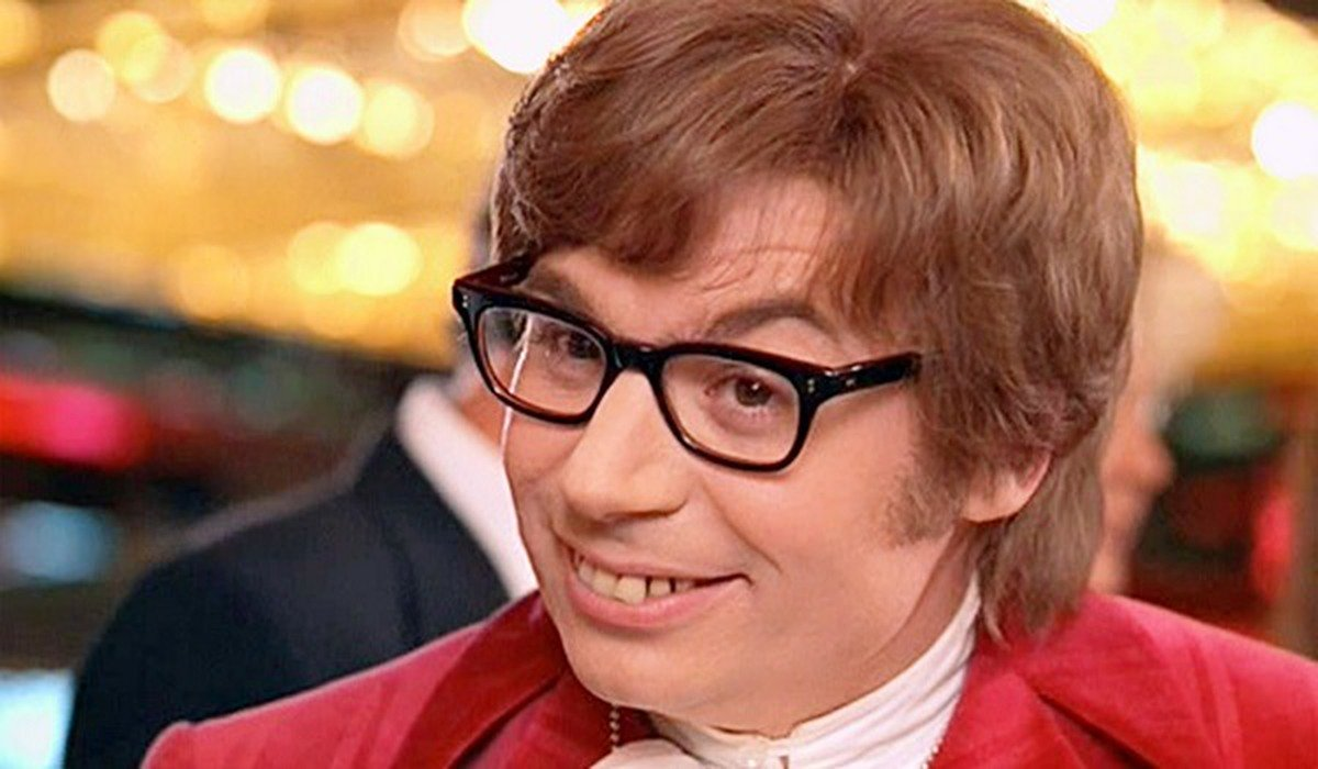 Austin Powers: International Man Of Mystery smiling at a casino table
