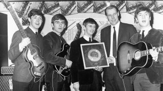 The Beatles with George Martin in 1964