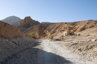 The entrance to the West Valley of the Valley of the Kings is seen here. in the West Valley, archaeologists are excavating what may be the tomb of Tut's wife. The house of Theodore Davis (1838-1915), a wealthy man who explored the Valley of the Kings, can
