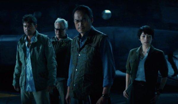 Godzilla: King of the Monsters Mark, Rick, Dr. Serizawa, and Dr. Chen staring at the ice