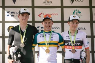 Second-placed Kelland O'Brien (St Kilda Cycling Club), winner Lucas Plapp and his InForm TM Insight Make teammate Carter Turnbull in third place share the under-23 men's time trial podium at the 2020 Australian Road Championships