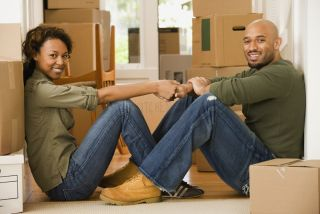 A man and a woman with moving boxes