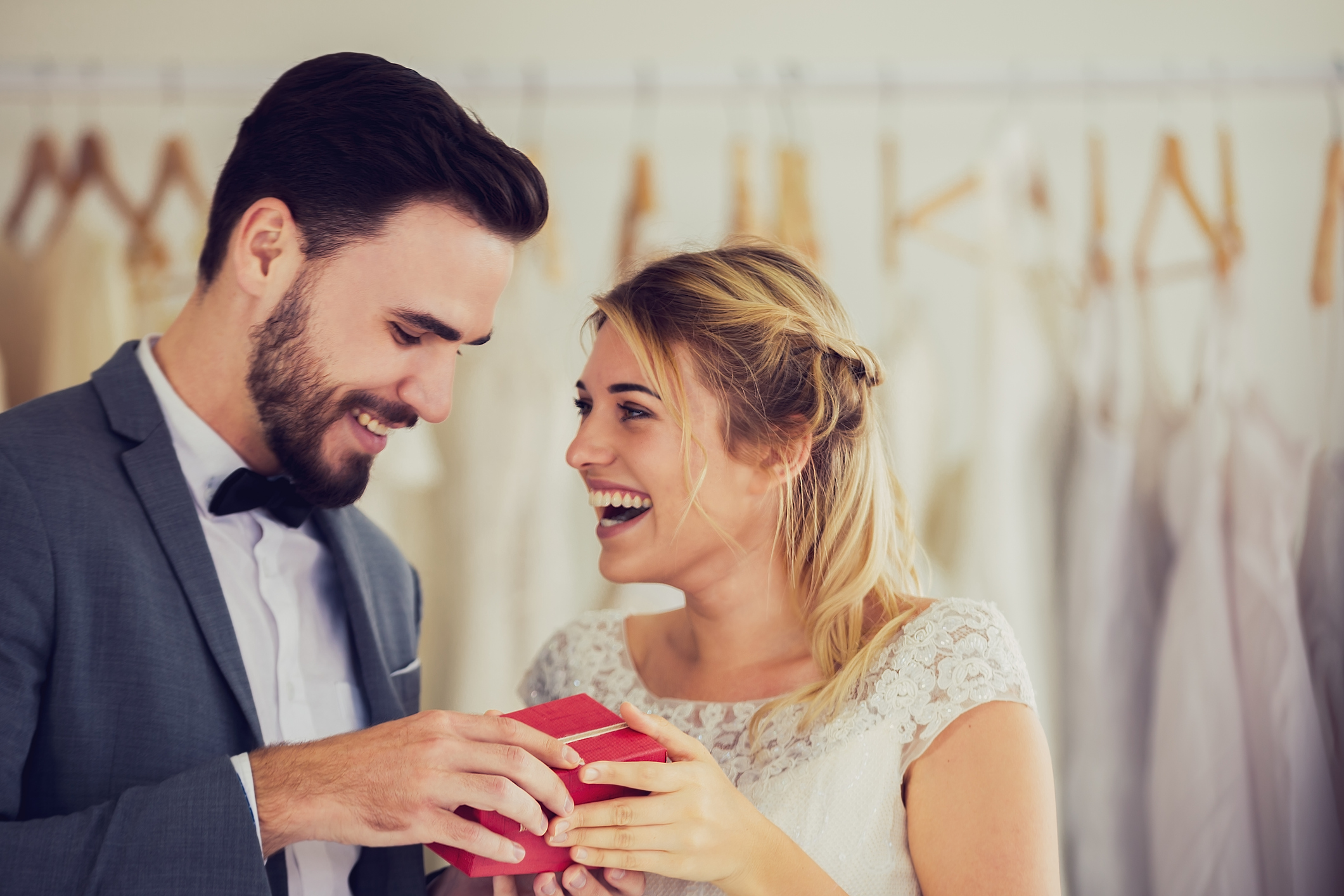 Man and woman opening engagement gifts for couples