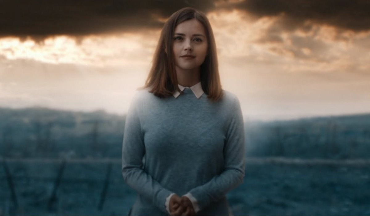Doctor Who Clara Oswald stands in a glowing light