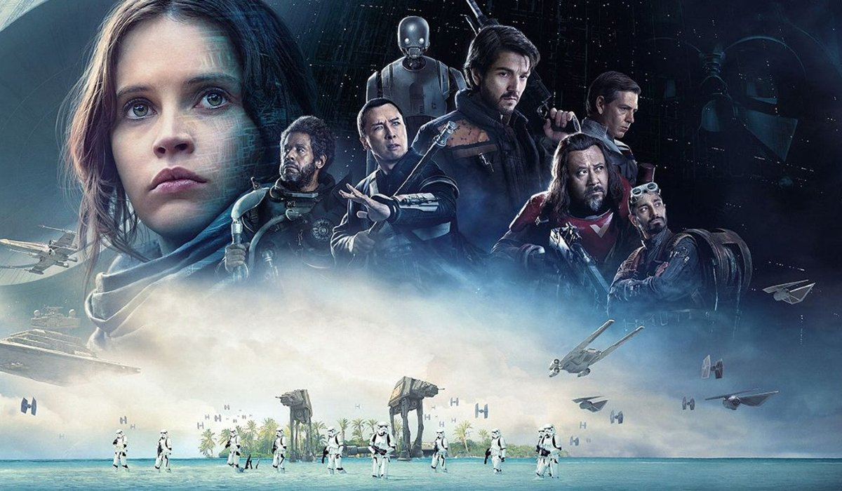 Rogue One: A Star Wars Story the heist team in front of Vader and the Death Star's shadows