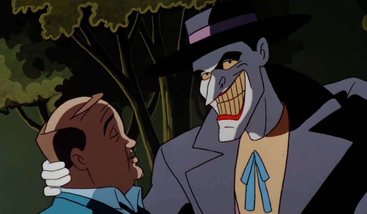 Batman: The Animated Series Joker grabs a guy by the neck in the park