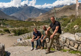 Freddie, Chris and Paddy on a wall in Nepal
