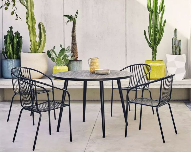 Habitat garden furniture set, 4 seater metal set on a terrace surrounded by plants