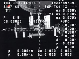 A camera aboard Russia's unmanned Progress 50 cargo ship captured this view of the International Space Station just after undocking on July 25, 2013.