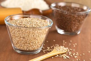 Flax seeds and sesame seeds in a bowl