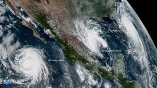 An image from the National Oceanic and Atmospheric Administration (NOAA)'s GOES-West satellite shows three tropical storms near North America at 1:20 pm EST Sept 3, 2019. From left to right: Hurricane Juliette, a Category 3 storm, is not expected to impact land; Tropical Storm Fernand is expected to landfall in Mexico; Hurricane Dorian, now a Category 2 after its devastation of the northwest Bahamas, has grown in area and is making its way toward Florida.