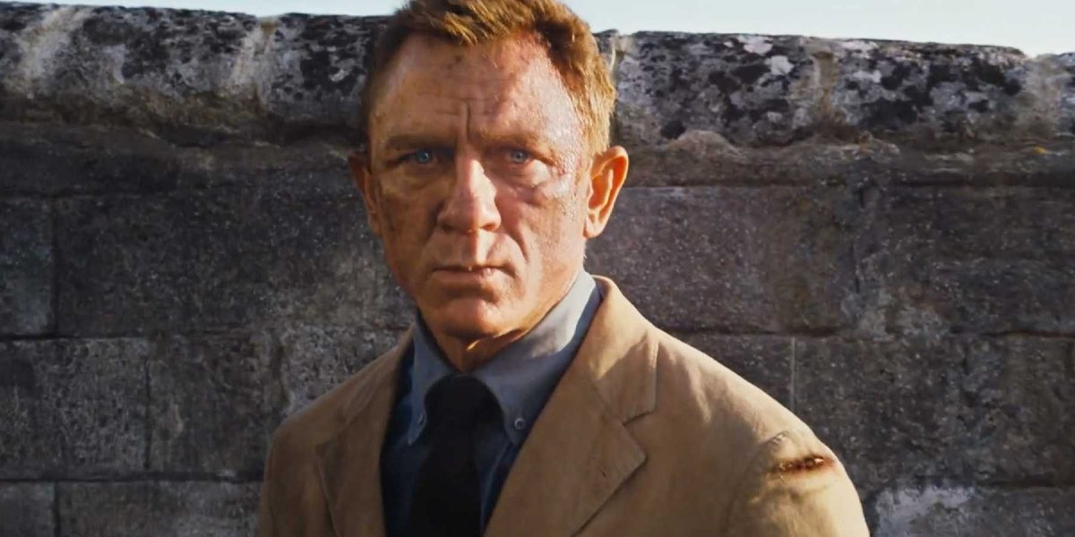 No Time To Die Daniel Craig stern faced in front of a crumbling wall