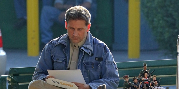 Welcome to Marwen Mark Hogancamp (Steve Carell) looking at photos on bench