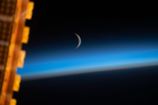 An astronaut captured this image of the crescent moon from the International Space Station while the orbiting laboratory was above the Sea of Japan.