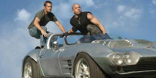 Paul Walker and Vin Diesel on top of a car