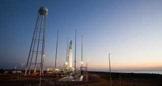 Antares on launch pad at sunrise