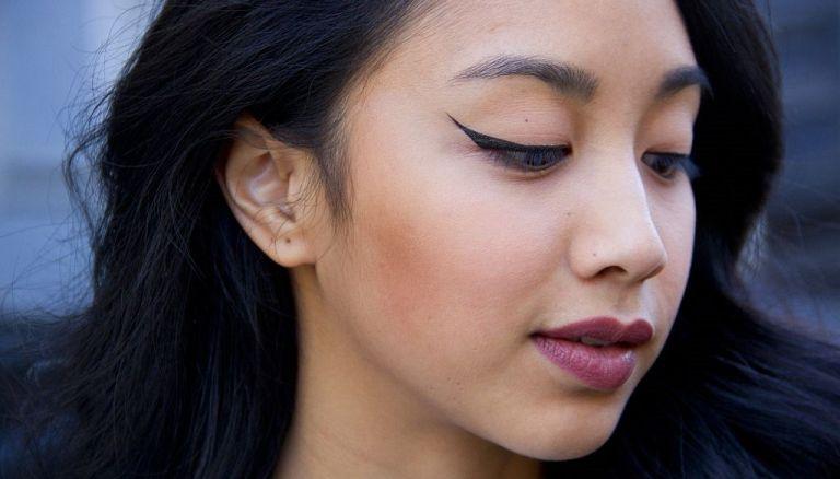 Mai Nguyen with cat eye black eyeliner on November 11, 2016 in New York City - reverse cat eye