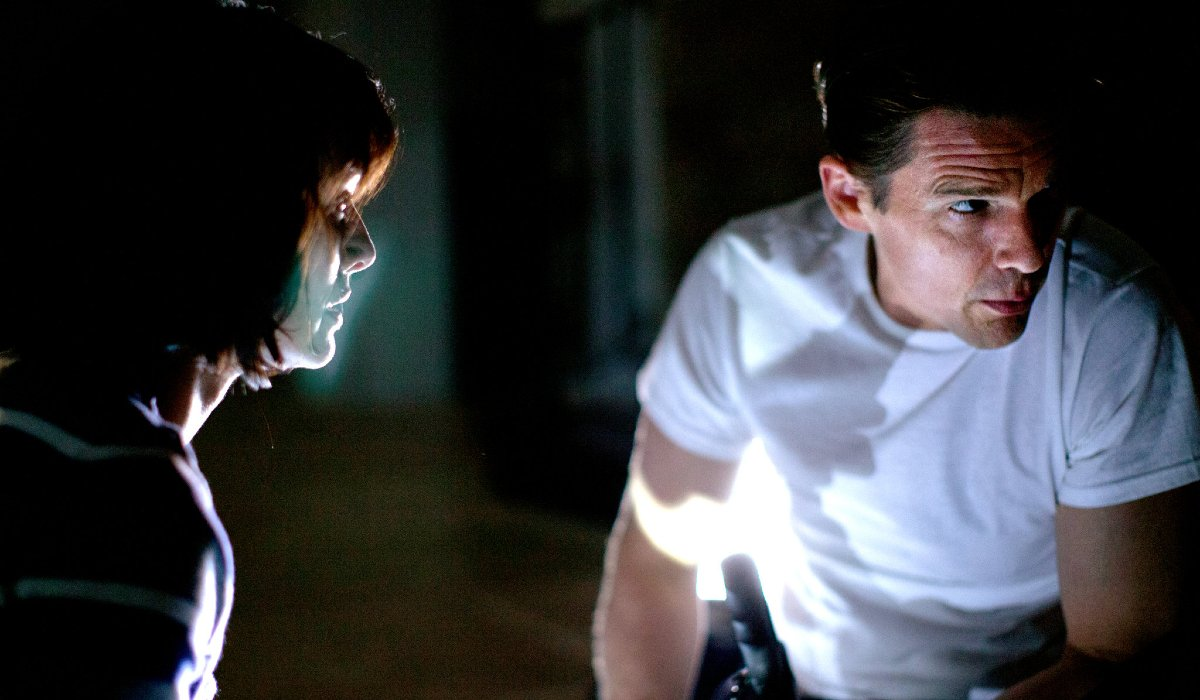 Lena Headey and Ethan Hawke make a plan in The Purge.