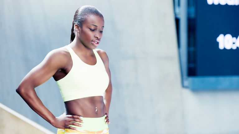 Woman doing a tough workout to offset a sedentary lifestyle