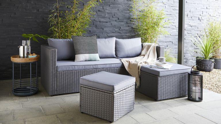 garden furniture sales: grey rattan set outdoors on patio