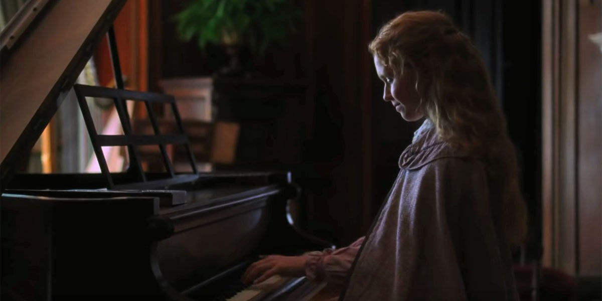 Beth playing Mr Laurence's piano in Little Women 2019